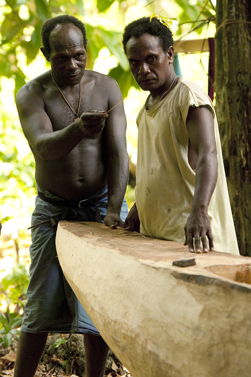 Ambrose Katlih, the Master carver identifies a fault and instructs to Isidore Lumnga how to fix it.