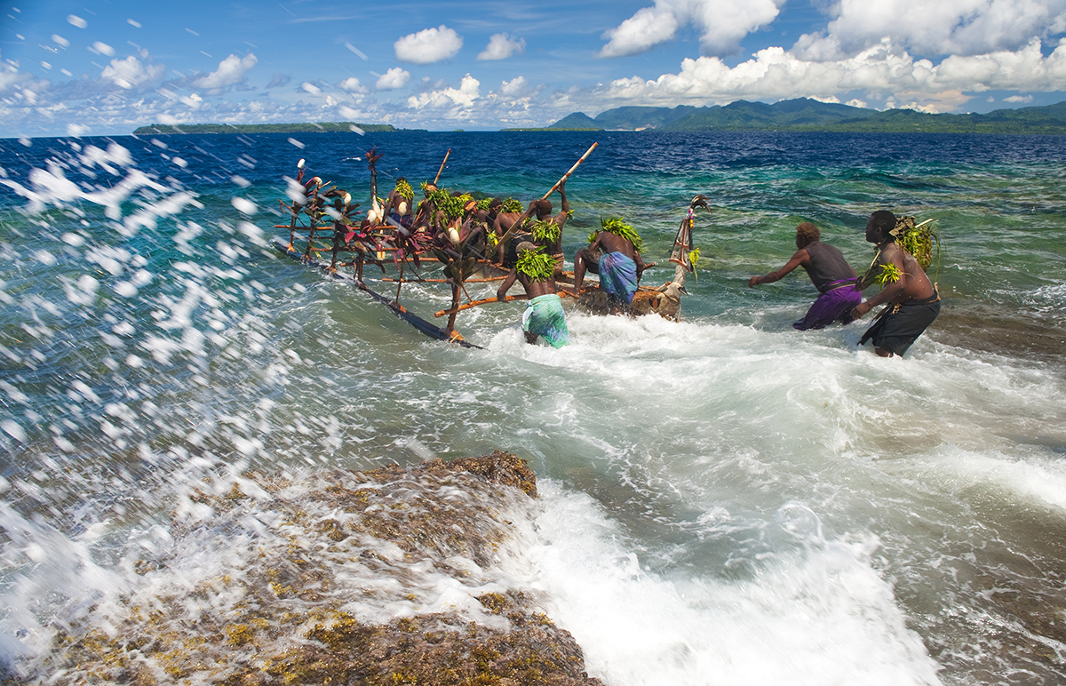 The happiest moment of the launch came when the kabelbel canoe is pushed out in to the sea through the reef passage that has been used for centuries.